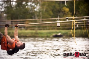 rope traverse over water at spartan obstacle race